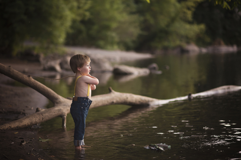 Levi-fishing-at-river-in-Oregon-with-stick